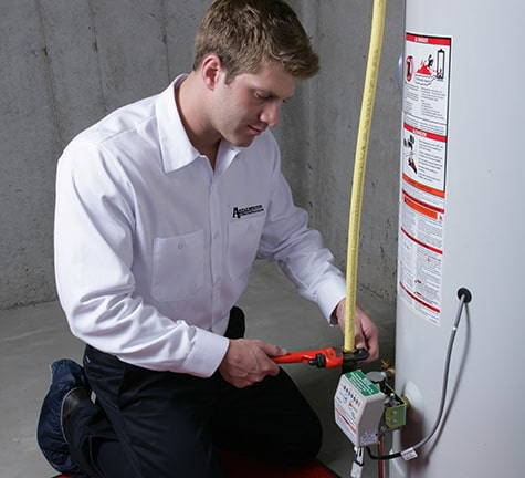 Plumber Repairing Water Heater in Denver, CO