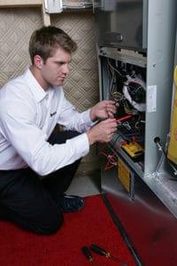 hvac-technician-with-furnace