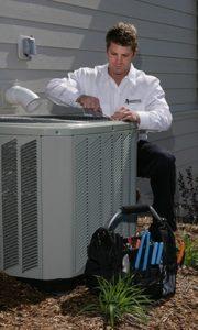 hvac-technician-with-compressor