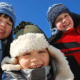 three-kids-outside-in-winter