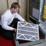 Applewood HVAC Technician with Furnace Filter