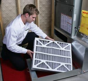 HVAC Technician with Furnace Filter 6