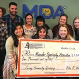 Applewood Awards $1,000 check to Muscular Dystrophy Association