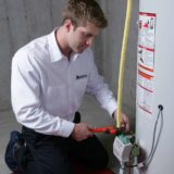 Applewood plumber-fixing-water-heater