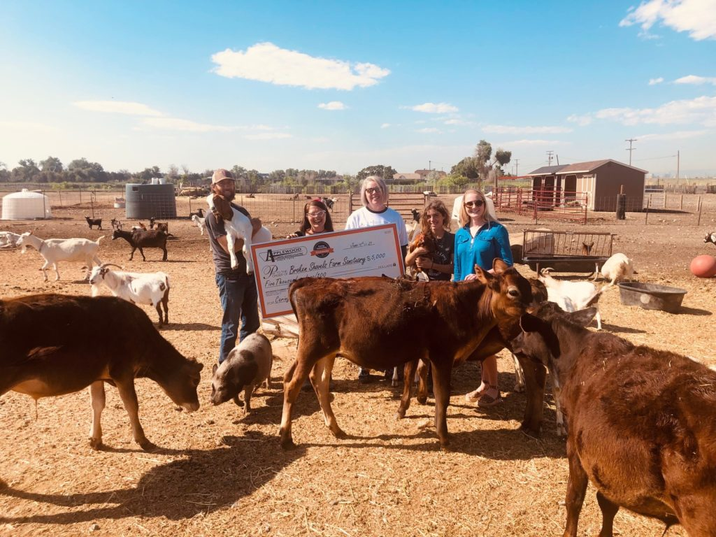 Broken Shovels Farm receives their donation from Applewood Plumbing.